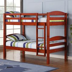 Elegance and function combine to give this contemporary wood bunk bed a striking appearance. This cherry bed includes full-length guardrails and an integrated ladder. Unlike other twin bunk beds, this bed also converts into two twin beds.