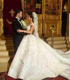 You may now kiss the bride ❤ •••••••••••••••••••••••••••••••• ▪Wedding dress : Rami kadi @ramikadi . ▪Photographer: Pulse @pulseproduction ▪Hair dresser : Wassim morkos @wassimmorkos @houssamkaoun. ▪Wedding planner : Matisse events @matisseevents. ▪Makeup artist: Bassam fattouh @bassamfattouh. ▪Jewelry: Yessayan @yessayan ••••••••••••••••••••••••••••••••• #lebaneseweddings @carineaa #carinegeorges @gaoude