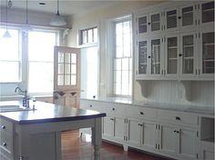 Fantastic Arts & Crafts Craftsman kitchen renovation with white cabinets. Beadboard backsplash and corbels