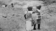 children - kids - uganda - sad - crying - village - rural - chores - tears - sorrow - black - white - people