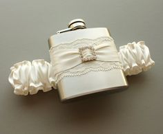 Ivory FLASK GARTER with Rhinestone Buckle  Ivory by MoonshineBelle, $40.00-- not sure if this crosses the line from funny to trashy or not...