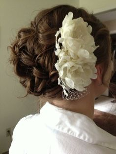 Wedding updo with fascinator