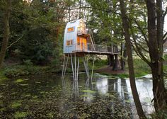 Treehouse Solling is raised above an artificial lake on stilts.
