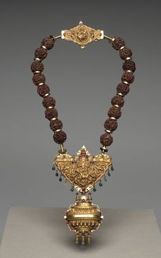 Tamil Nadu, India | Gowri Shankaram Necklace |  early 19th century | Rudraksha berries, gold, rubies and garnets