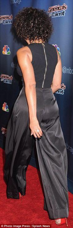 Vampy lipstick too: Also rocking a black ensemble was former Spice Girl Melanie Brown, who...