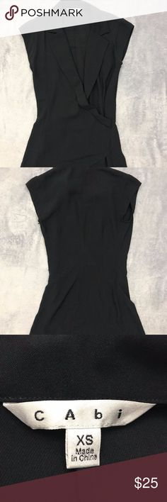CAbi Black XS Sleeveless Wrap Blouse Item: CAbi Women's XS Black Sleeveless Wrap Silky Career Blouse  Size: XS Refer to measurements below for accurate fit! Measured flat:  17       inches armpit to armpit 28       inches from collar seam to shirttail        Base Color:  Black Please look at photos for better description CAbi Tops Blouses