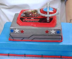 Learn how-to make a 2-tier Marvel's Avengers: Age of Ultron cake, featuring a spinning gyroscope DecoSet® cake topper and Earth's Mightiest Heroes, including Iron Man, Captain America, Thor, The Incredible Hulk, and Hawkeye.