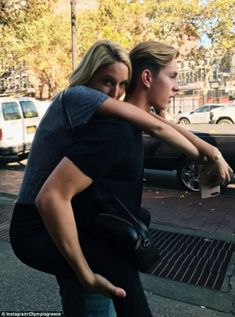 Prince Constantine of Greece gives his sister Maria Olympia a piggy back ride in New York