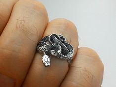 Snake Silver Ring  Ring fits on finger with circumferences from 6.5 to 15 size (US). Width: 0.71 in. or 18 mm. Length(from the tail to the head): 0.83 in. or 21 mm. Material: • Silver 925.  Symbolic Snake Meanings  ♦Cycles ♦Rebirth ♦Patience ♦Fertility ♦Eternity ♦Balance ♦Cunning ♦Intuition ♦Awareness ♦Healing ♦Intellect ♦Protection ♦Solemnity ♦Rejuvenation ♦Transformation ♦Occult (hidden) Knowledge ♦Male/Female, Duality   ♥ Follow the link below to view all items…