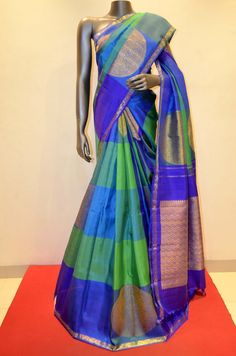 Exqusite Checks Kanjeevaram Silk With Traditional Chakram Zari Buttas Product Code: AB202566 Online Shopping: http://www.janardhanasilk.com/index.php?route=product/product&search=AB202566&description=true&product_id=3698