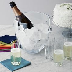 A bottle of bubbly nestled in ice is a lovely sight, especially when viewed through our classic-meets-contemporary handcrafted glass bucket. Wide bowl tapers its silhouette as it thickens to a solid sham base. Prunt handles add a dollop of design, and the machine-cut and melted rim is durable, able to withstand clanking of bottles.