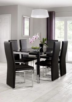 A sophisticated and contemporary combination of chrome and black glass create the Tempo dining table