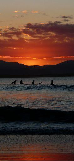 Surfers at Sunset, Byron Bay, Australia