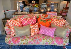 Wow! Sofa covered in a pink and orange vintage Suzani. Love Anna Spiro design.