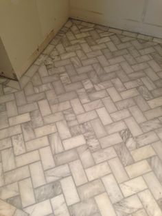 herringbone tile floors - grey grout