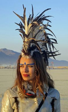 30 Brilliant Burning Man Costumes to Buy and DIY via Brit + Co. 30 Brilliant Burning Man Costumes to Buy and DIY via Brit + Co. Burning Man Outfits, Burning Man Fashion, Africa Burn, Burning Man 2016, Male Makeup, Warrior Makeup, Feather Headdress, Mode Boho, Poses