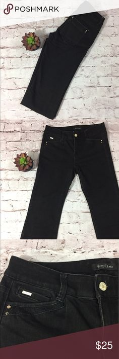 White House Black Market Modern Flare Black Jeans Great Condition, modern flare fit with a slimmer leg and a  flared leg opening.  Has stretch and an inseam of 32 inches, 7 1/2 inches at the knee and 9 inch leg opening. White House Black Market Jeans Flare & Wide Leg