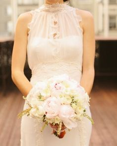 Peonies, roses, pieris, and ranunculus made up bride Charlene's gorgeous bouquet.