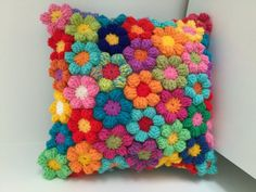 Crochet flower cushion pillow cuscini kussen wool hand made flowers hippie boho colourful rainbow floral unique gift Colour and style inspiration- A rainbow crochet flower cushion which is hand made with lots of colour confidence. A stunning crochet cushi Crochet Puff Flower, Bag Crochet, Crochet Home, Crochet Crafts, Crochet Flowers, Fabric Crafts, Crochet Projects, Crotchet, Crochet Baby