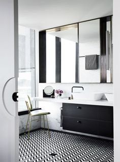 A bright, white and modern bathroom with marble detailing