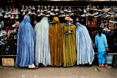 'Afghan women at shoe store', 1992. | 24 Striking Pictures Of Afghanistan By Photojournalist Steve McCurry