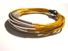 Yellow Leather Cuff #Bracelet with Silver Tube by wrapsbyrenzel