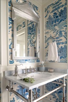 blue & white chinoiserie toile wallpaper in the powder room