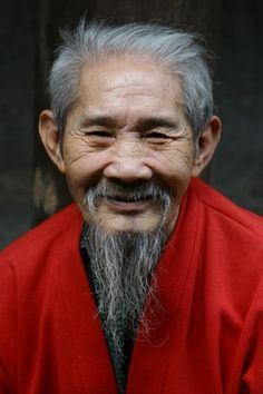 Vietnamese elder has lines of time written on his skin.