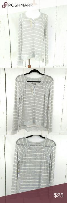 """NWT Nine West Vintage America Grey & White Sweater NWT. Mint condition. Great for fall!   Size M. 19"""" pit to pit flat across, 26"""" sleeves, 28"""" shoulder to hem in back, 26"""" shoulder to hem in front (high-low,) 26"""" sleeves. Second photo is 100% true to color.   Super soft and lightweight Nine West Vintage America grey and white striped, high-low sweater top. Loose weave (will need a cami or bralette,) with mild glimmer spun throughout. Lace and button bust detail with a Vneck. Has stretch…"""