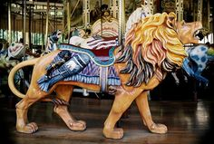 Beautiful mane and trappings on this standing lion on the Golden Gate Park carousel, San Francisco