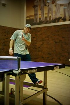 Tim Tebow playing ping pong. My sill man  ) Football Field 53a207460
