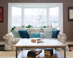 Try quilts as a cover, it's an economic and stylish way to update an old couch