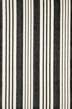 Our woven cotton area rugs are so adaptable they make themselves at home in any room. Constructed using a hand loomed flat weave in durable 100% cotton, these rugs are lightweight, reversible and affordable.   Birmingham Black also available in indoor/outdoor PET (recycled polyester).