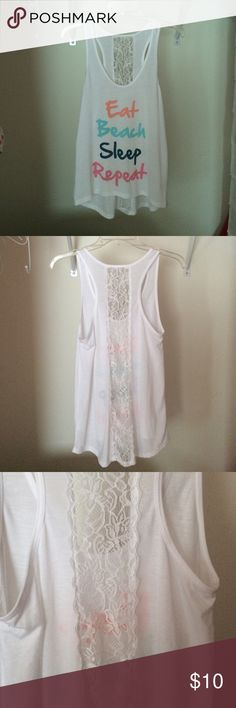 Eat Beach Sleep Repeat Tank A see-through white tank top with the words Eat Beach Sleep Repeat in succession.  Has a high low effect and crochet like flower pattern on the back.  Only tried on once, never worn. Claire's Tops Tank Tops