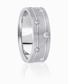 Dual High Polished Channels Are Accented By Flush Set Diamonds In This Exemplary Wedding Ring