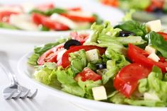 Spring green salad with olives and cheese