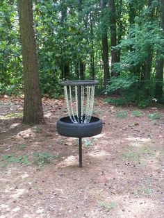 Homemade disc golf hole. I wish actual courses would incorporate the rubber bottom and top. I have really banged up and cut some of my discs (even star plastics) from hitting the basket off of drives.