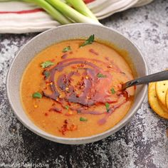 Egyptian red lentil soup on a grey bowl with green onions and crackers on the back. Egyptian Food, Egyptian Recipes, Grey Bowls, Middle Eastern Dishes, Red Lentil Soup, Taco Soup, Vegan Soup, Vegetable Salad, Green Onions