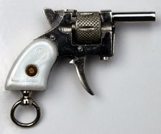 Berloque miniature Revolver of 2mm HS Kolibri. Pistol of bracket. Rare German miniature.