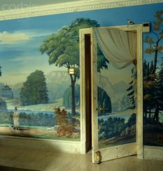 Trompe l'oeil drapery by Pierre-Marie Rudelle is painted on the back of the open door to the dining room with a bird perched on the door frame - 42-30626948 - Rights Managed - Stock Photo - Corbis