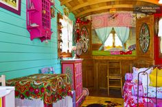 Another colorful gypsy wagon -- this one in a garden in Paradou.