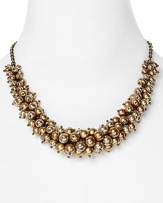 """Carolee Golden Rules Bronze Cluster Necklace, 18"""" PRICE: $75.00 Skip the standard strand and opt for pearls with shine. Wear Carolee's high-impact bib with a simple white tee to put the jewels in focus. 12 kt. worn gold plated brass/glass pearls. Imported. Lobster closure 18"""" L, 2"""" extension Photo may have been enlarged and/or enhanced Web ID: 553490"""