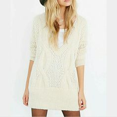Urban Outfitters V  Neck Sweater NWOT Urban Outfitters, Kimchi Blue Sweater. Pretty cream colored v-neck sweater/dress. Size small. Urban Outfitters Sweaters