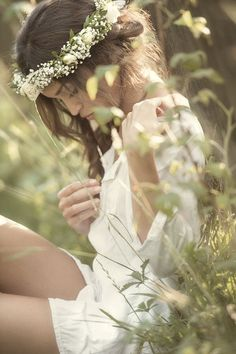 in the meadow, in a white floral crown