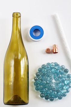 DIY: Wine Bottle Citronella Candles | HelloNatural.co
