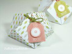 Eine Anleitung für eine kleine Geschenkschachtel, gefaltet aus dem neuen…