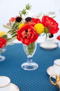 Use a sundae glass for a little flower arrangement - great idea!