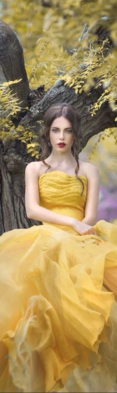 """Belle in her iconic yellow gown from Disney's """"Beauty and the Beast."""" Photography by Margarita Kareva. Pretty Quinceanera Dresses, Yellow Gown, Jaune Orange, Disney Beauty And The Beast, Mellow Yellow, Color Yellow, Yellow Fashion, Shades Of Yellow, Poses"""