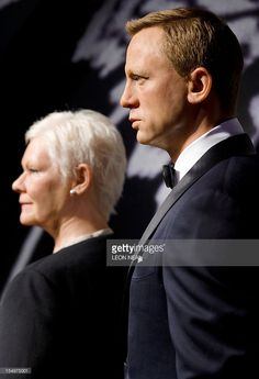 Wax figures of British actors Dame Judi Dench and Daniel Craig are unveiled at Madame Tussauds in London on October 29, 2012 after they were re-dressed in original costumes from the newly released Skyfall James Bond film.
