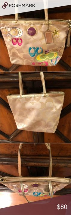 Khaki coach tote Coach signature light khaki applique tote bag multi color purse. This is used. No rips or tears all signs of wear are shown in pictures. Serial number is F1169-F17587. It is big enough to fit my ipad pro 10.5 with still space left in bag. Coach Bags Totes